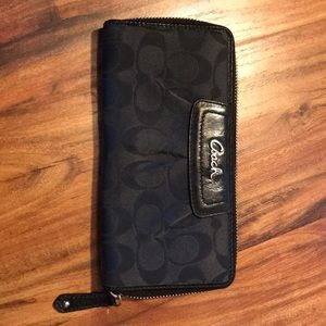Black accordion Coach wallet